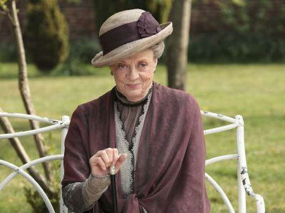 """FILE - In this image released by PBS, Maggie Smith as the Dowager Countess Grantham, is shown in a scene from the second season on """"Downton Abbey."""" The fourth season of the popular British series will premiere in the U.S. on Jan. 5, 2014. (AP Photo/PBS, Carnival Film & Television Limited 2011 for MASTERPIECE, Nick Briggs) Photo: AP / PBS"""