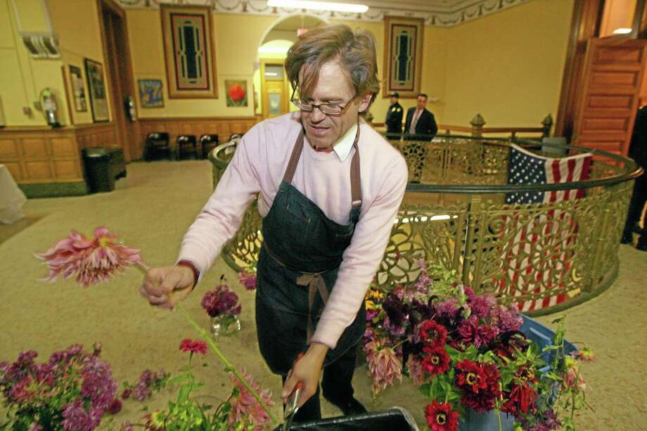 Paul McClure of A Lighter Shade of Pink Events of NYC prepares flowers before the first same-sex marriage  at City Hall in Jersey City, NJ, Sunday, Oct. 20, 2013. (AP Photo/The Record, Kevin R. Wexler) Photo: AP / The Record