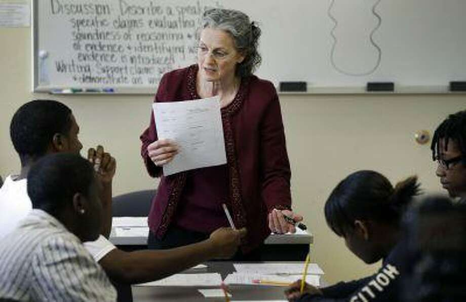 In this Thursday, April 11, 2013 photo, Deni Loving teaches a GED class in Kansas City, Mo. Photo: ASSOCIATED PRESS / AP2013