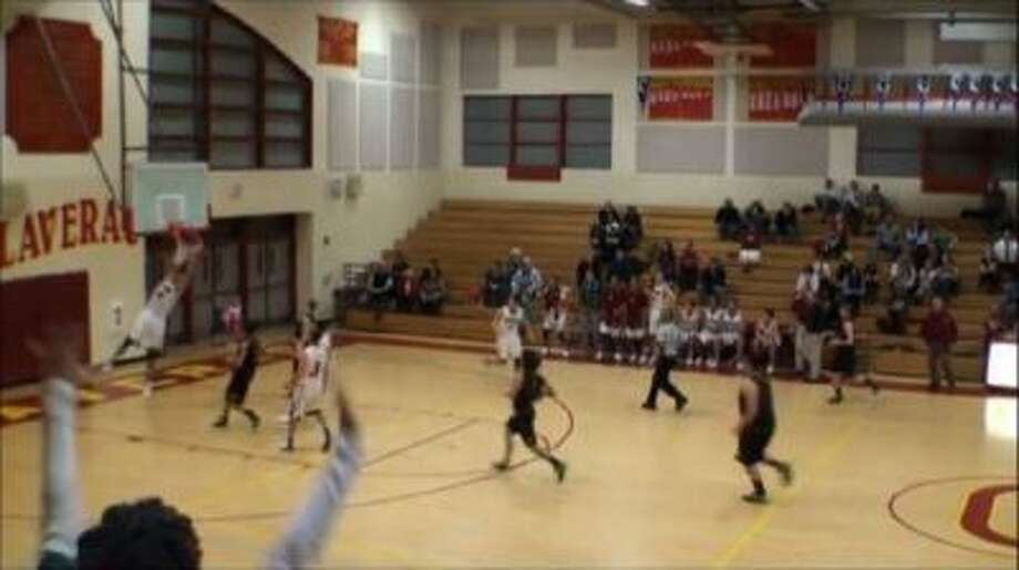 Kyle Gouveia breaks the glass with this dunk.