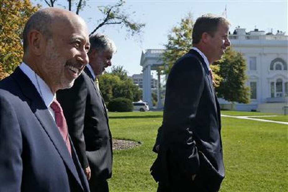From left, The Goldman Sachs Group, Inc. Chairman and CEO Lloyd Blankfein, American International Group President and CEO Robert Benmosche, and GE Capital Chairman and CEO Keith Sherin, and other financial sector leaders arrive at the White House on Oct. 2 for a meeting with President Barack Obama regarding the debt ceiling and the economy. Photo: AP / AP