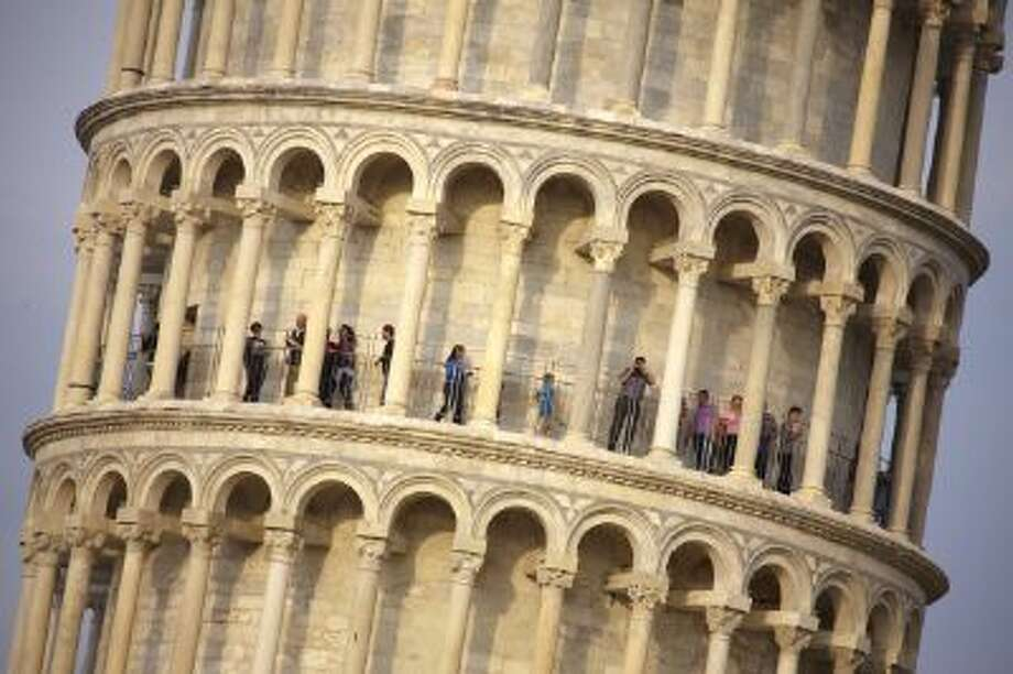 Tourists visit the leaning tower of Pisa, free of scaffoldings for the first time after 20 years of stabilization and restoration works on April 26, 2011. Photo: AFP/Getty Images / 2011 AFP