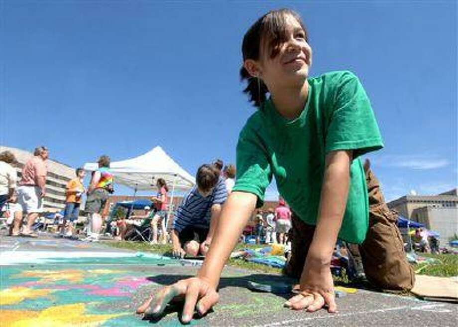 FILE - In this July 2007 file photo, Madeline Kara Neumann, of Weston, Wis., is shown working on chalk art last summer during downtown Wausau's Chalk Fest. Neumann died Sunday, March 23, 2008, after her parents prayed for healing rather than getting medical help for a treatable form of diabetes. On Wednesday, July 3, 2013, the Wisconsin Supreme Court ruled that her parents were properly convicted of homicide. (AP Photo/Wausau Daily Herald, Butch McCartney, File) Photo: AP / Wausau Daily Herald