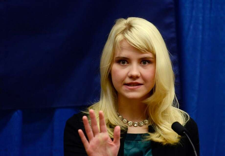 Elizabeth Smart speaks to reporters regarding her advocacy of child protection and the healing process she has experienced, prior to her presentation at the Child Sexual Abuse Conference, Tuesday, Oct. 30, 2012, in State College, Pa. Smart was abducted in 2002 and held prisoner for nine months before being reunited with her family. (AP Photo/Ralph Wilson) Photo: ASSOCIATED PRESS / AP2012