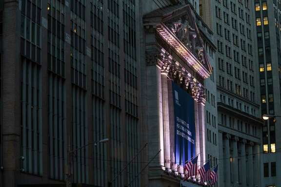 FILE - This Tuesday, Oct. 25, 2016, file photo shows the New York Stock Exchange, in lower Manhattan. Stock markets turned higher on Tuesday, July 25, 2017, as investors monitored a slew of corporate earnings reports. A meeting of the Federal Reserve and caution over potential twists and turns in U.S. politics kept most indexes trading within a narrow range. (AP Photo/Mary Altaffer, File)
