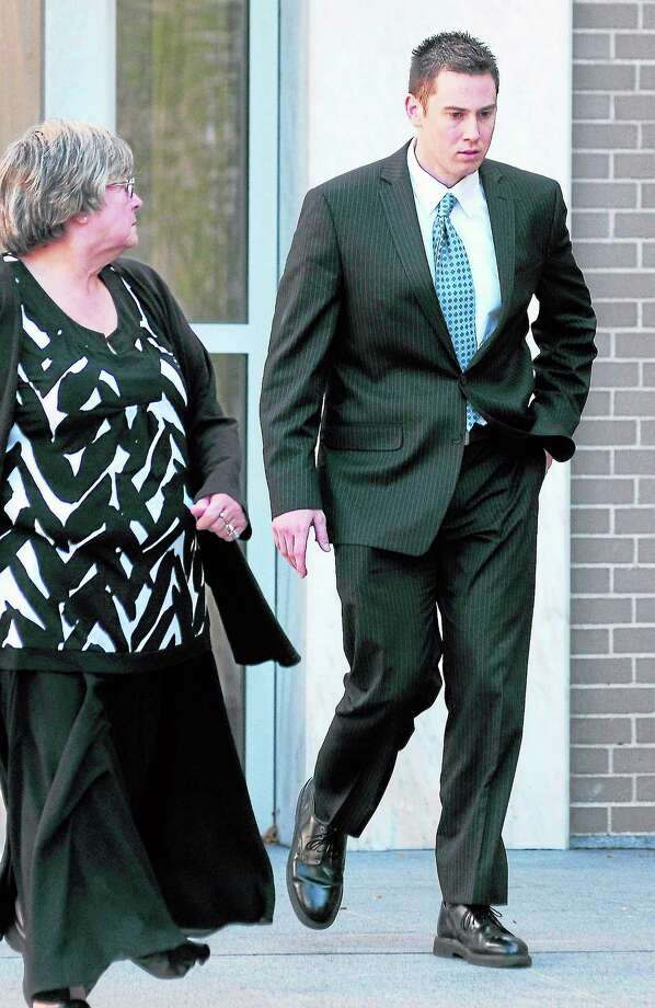 Above: Former East Haven Police Officer David Cari, center, walks to the United States Courthouse in Hartford with his attorneys Erick Russell, left, and Alex Hernandez.  Right: Former East Haven Police Officer Dennis Spaulding, right, and his mother walk out of the United States Courthouse in Hartford Monday. Photo: Arnold Gold Photos —New Haven Register
