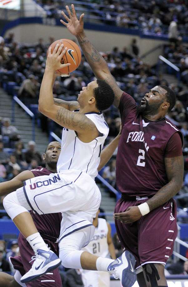 Connecticut's Shabazz Napier, left, drives past Fordham's Travion Leonard during the second half of an NCAA college basketball game in Hartford, Conn., Friday, Dec. 21, 2012. Connecticut won the game 88-73. (AP Photo/Fred Beckham) Photo: ASSOCIATED PRESS / AP2012