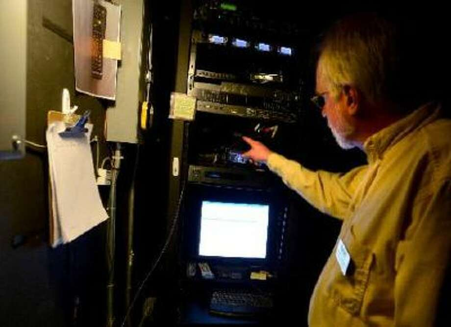Neal Thompson monitors the projection equipment at the Boedecker Theater in the Dairy Center for the Arts in Boulder. Photo: DC / (C) 2012 Boulder Daily Camera, MediaNews Group, Prairie Mountain Publishing http://www.dailycamera.com/ http://www.buffzone.com/