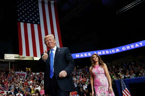 President Donald Trump and first lady Melania Trump arrive for a rally, Tuesday, July 25, 2017, at the Covelli Centre in Youngstown, Ohio