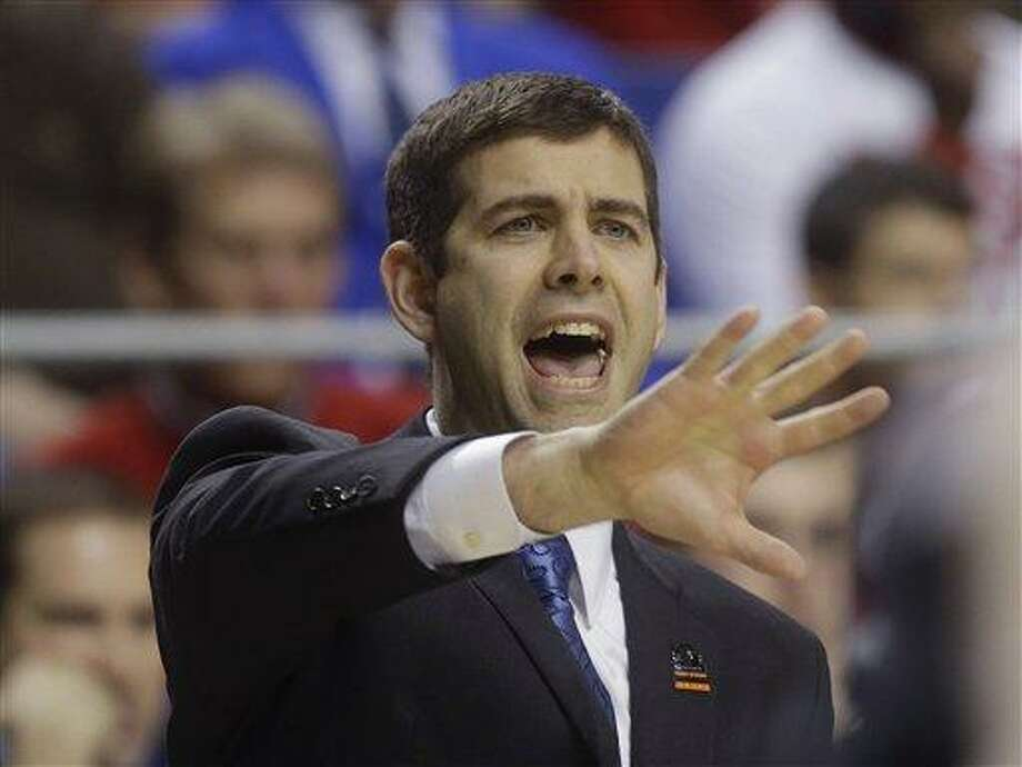 Butler head caoch Brad Stevens reacts in the first half of a third-round NCAA college basketball tournament game against Marquette, Saturday, March 23, 2013, in Lexington, Ky.  (AP Photo/John Bazemore) Photo: AP / AP