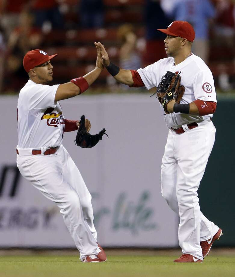 St. Louis Cardinals' Jon Jay, left, and Carlos Beltran celebrate following a baseball game against the New York Mets on Tuesday, May 14, 2013, in St. Louis. The Cardinals won 10-4. (AP Photo/Jeff Roberson) Photo: AP / AP