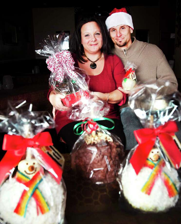 (Melanie Stengel — New Haven Register  Michelle Diaz and partner, Michael Kryzkij with some of their holiday Apples on a Stick. Photo: Journal Register Co.