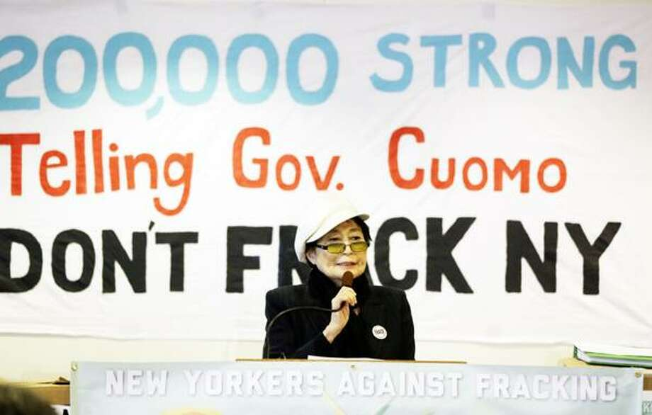 """Yoko Ono speaks during a news conference opposing hydraulic fracturing on Friday, Jan. 11, 2013, in Albany, N.Y. Environmental, health and community groups opposed to shale gas drilling and hydraulic fracturing, or """"fracking,"""" say they collected more than 200,000 comments during an intense 30-day effort featuring online coaching and comment-writing workshops at churches, community centers, food co-ops, coffee shops and holiday house parties from New York City to Buffalo. (AP Photo/Mike Groll) Photo: AP / AP"""