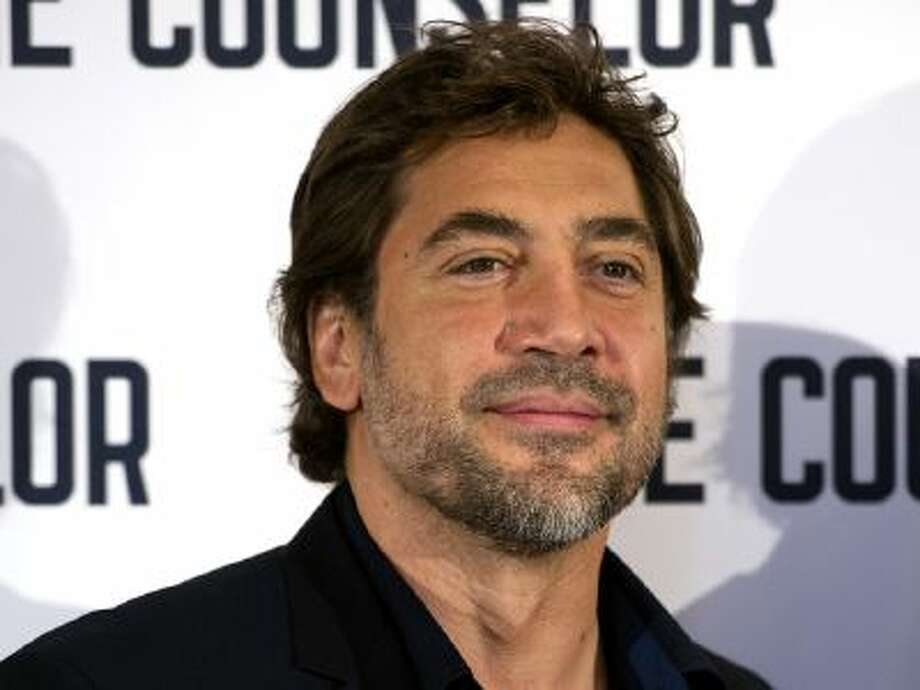 Spanish actor Javier Bardem poses for pictures during a photocall for his latest film 'The Counselor', directed by British Ridley Scott, in central London on October 5, 2013. / 2013 AFP
