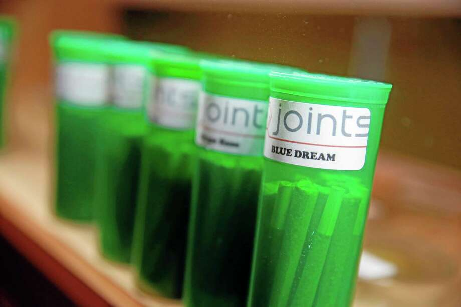 In this Dec. 6, 2013 photo, different strains of marijuana are displayed for sale at The Clinic, a Denver-based dispensary with several outlets, in Denver. The Clinic is among the roughly 150 medical marijuana dispensaries hoping to begin selling to recreational users when it becomes legal to sell on Jan. 1, 2014. The state's hopeful pot shops are so mired in red tape and confusion that no one knows yet when or if they'll be allowed to open. Not a single shop will clear state and local licensing requirements until about Dec. 27. (AP Photo/Brennan Linsley)(AP Photo/Brennan Linsley) Photo: AP / AP
