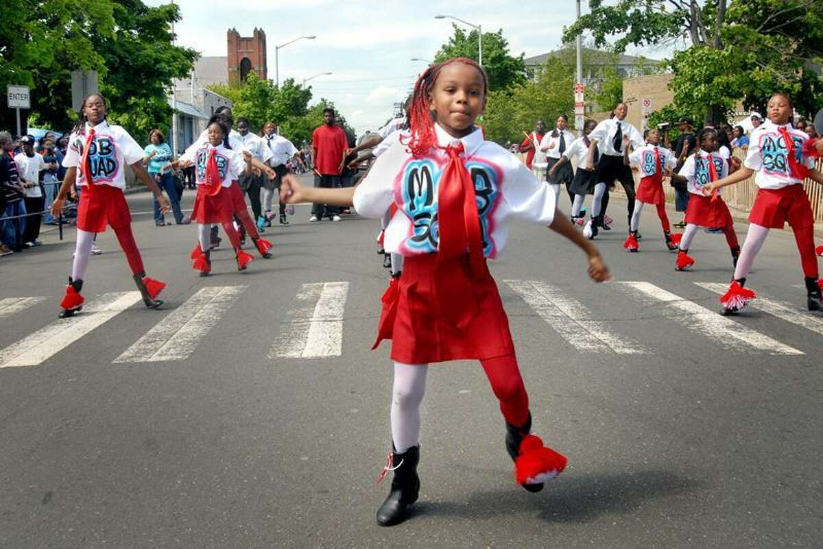 (ms052007)5/20/07_FREDFIX-Destiny Reyes,7, leads the way as the Mob Squad drill team makes it's way up Dixwell Ave. in the Freddie Fixer Parade. Melanie Stengel/Register