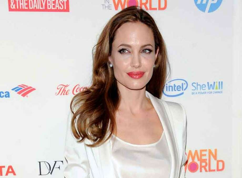 FILE - This March 8, 2012 file photo shows actress Angelina Jolie at the Women in the World Summit  in New York. Jolie authored an op-ed for Tuesdayís May 14, 2013 New York Times where she writes that in April she finished three months of surgical procedures to remove both breasts as a preventive measure. She says sheís kept the process private but is writing about it now with hopes she can help other women. (AP Photo/Evan Agostini, file) Photo: ASSOCIATED PRESS / A2012