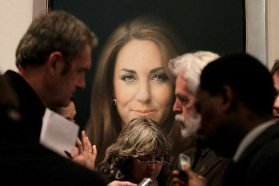Members of the media talk to artist Paul Emsley, center right, in front of his newly-commissioned portrait of Kate, Duchess of Cambridge, on display at the National Portrait Gallery in London, Friday, Jan. 11, 2013. (AP Photo/Sang Tan) Photo: ASSOCIATED PRESS / AP2013