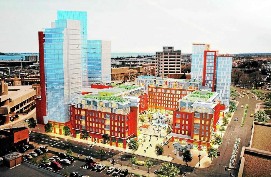 (Arnold Gold — New Haven Register)  An artist's rendering of the New Haven Coliseum site redevelopment plan is displayed at a meeting to solicit community input at The Bourse on Chapel St. in New Haven on 8/27/2013. Photo: Journal Register Co.