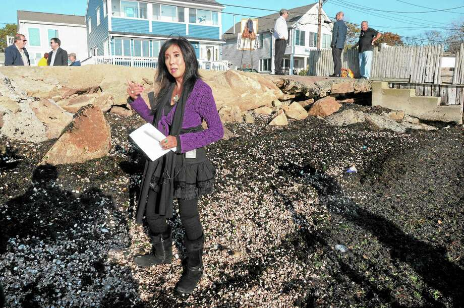 (Mara Lavitt — New Haven Register) October 121, 2013 East HavenThe sea wall and stairs at Shell Beach has badly eroded and deteriorated. Unhappy residents, including Kariann Price, visited the wall and spoke to the press about it. Photo: Journal Register Co. / Mara Lavitt