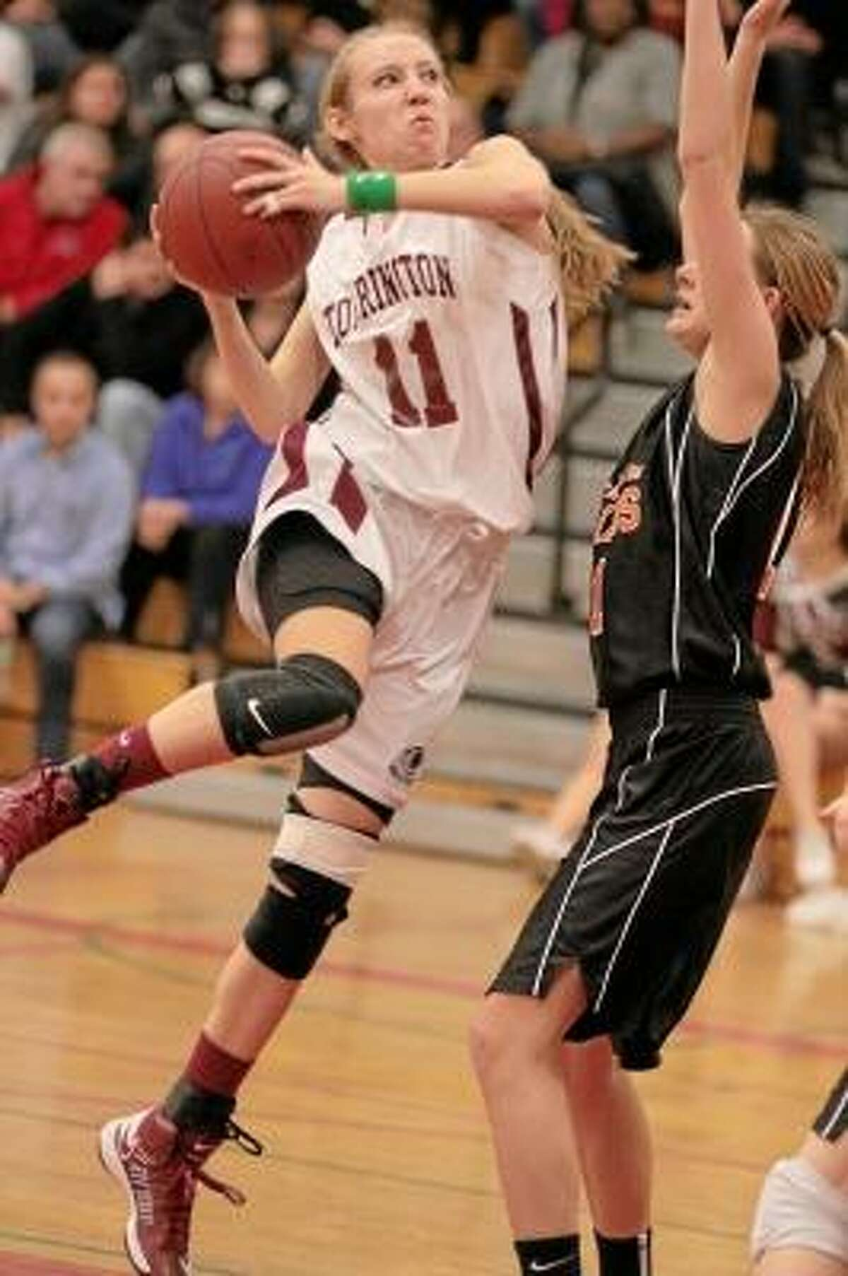 Nicole Kozlak of Torrington drives to the basket in her team's victory over Watertown Friday night. Photo by Marianne Killackey/Special to Register Citizen