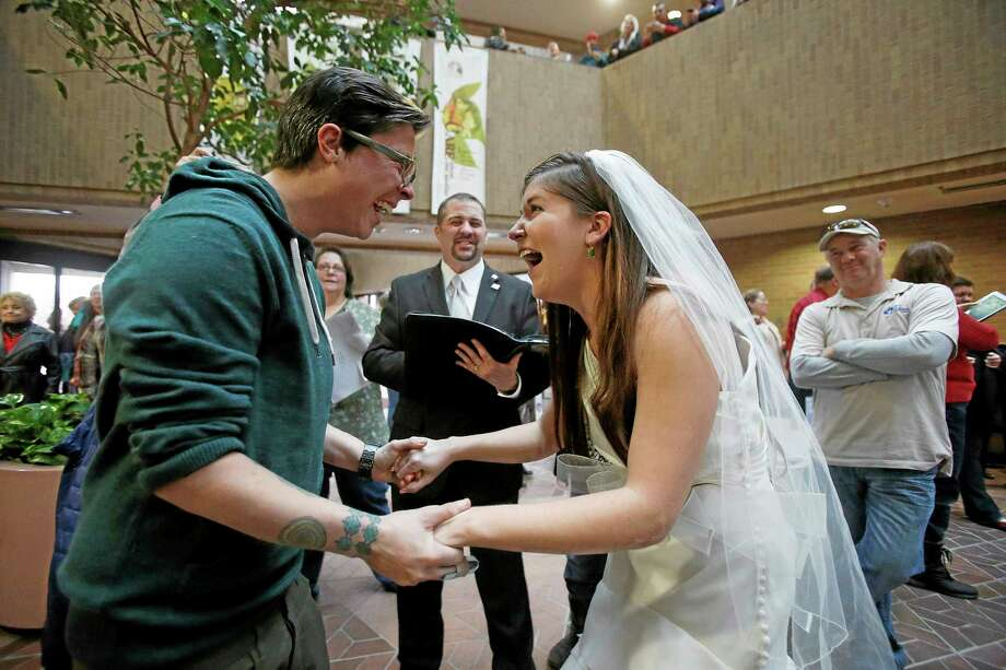 AP photo  Jax and Heather Collins get married at the Salt Lake County clerk's office Monday. Photo: AP / Deseret News