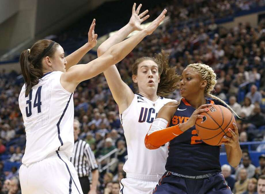 Mar 11, 2013; Hartford, CT, USA; Connecticut Huskies guard Kelly Faris (34) and forward Breanna Stewart (30) defend against Syracuse Orange guard Elashier Hall (2) in the first half during the semifinals of the Big East tournament at XL Center. Mandatory Credit: David Butler II-USA TODAY Sports Photo: USA TODAY Sports / David Butler II