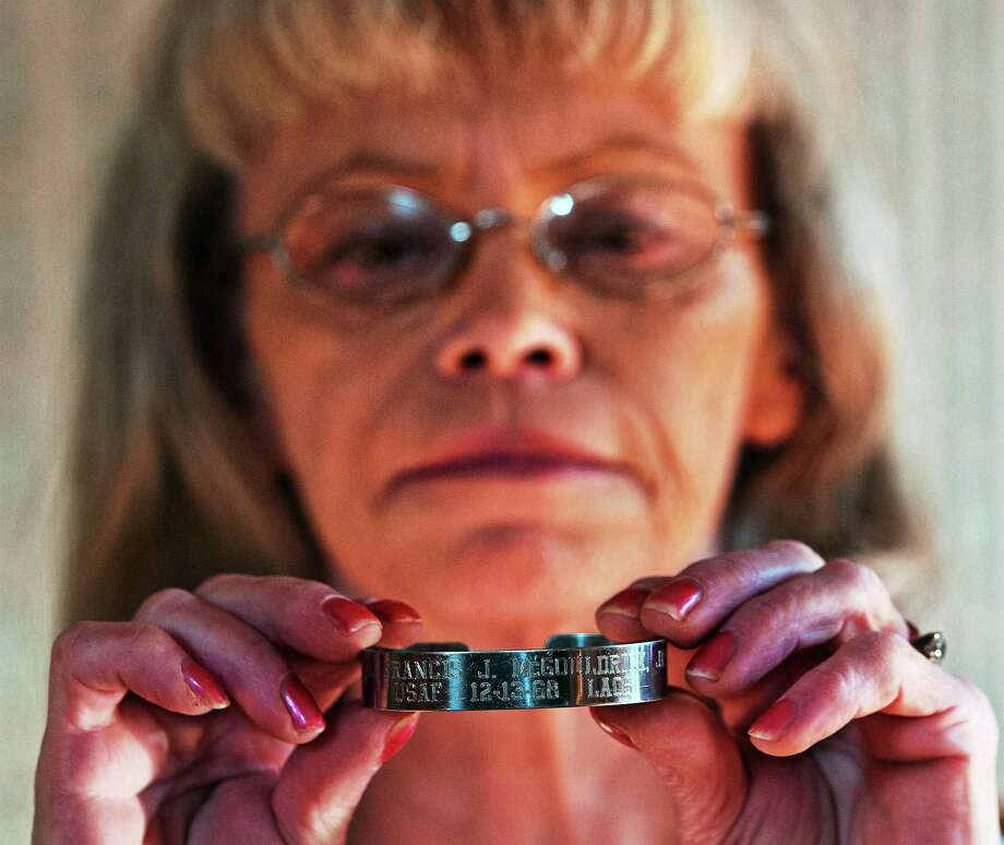 (Peter Casolino ó New Haven Register)   Darleen Hood of East Haven has had this POW/MIA bracelet for 30-years to honor those who never came back from the Vietnam war. She was shocked to see that the remains of Air Force Col. Francis J. McGouldrick Jr., were found and buried at Arlington Cemetery on December 13th. She now wants to give the bracelet to his family.  pcasolino@NewHavenRegister Photo: Journal Register Co.