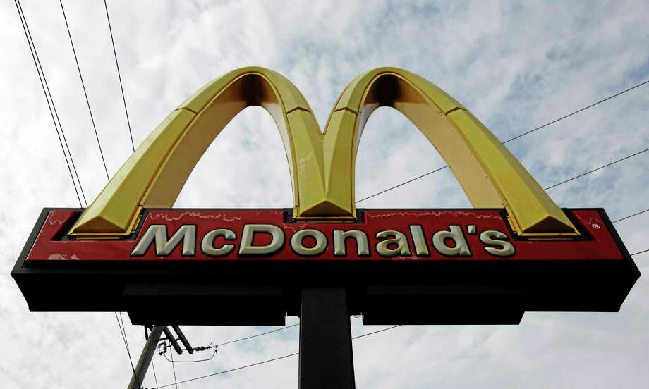 In this Friday, Oct. 4, 2013, photo, a McDonald's restaurant sign is seen at a McDonald's restaurant in Chicago. The company reports quarterly earnings on Monday, Oct. 21, 2013. (AP Photo/Nam Y. Huh) Photo: AP / AP