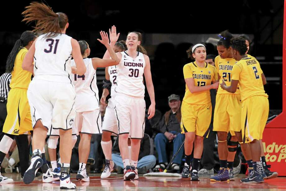 UConn's Breanna Stewart (30) celebrates with teammates after drawing a foul during the second half of Sunday's game against California. The Huskies won easily 80-47. Photo: John Minchillo — The Associated Press   / FR170537 AP
