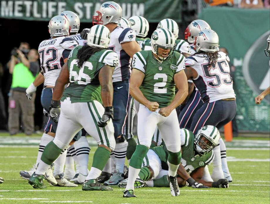 New York Jets kicker Nick Folk reacts after kicking the game-winning field goal during overtime against the Patriots on Sunday. Photo: Peter Morgan — The Associated Press   / AP