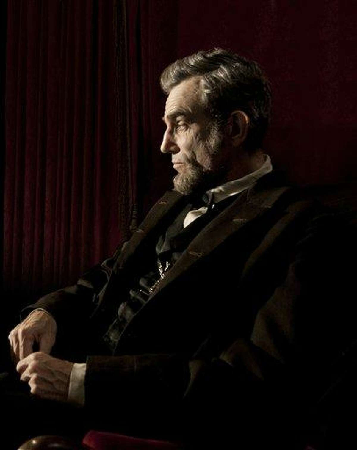 """This publicity film image released by DreamWorks and Twentieth Century Fox shows Daniel Day-Lewis portraying Abraham Lincoln in the film """"Lincoln."""" Best-picture prospects for Oscar Nominations on Thursday, Jan. 10, 2013, include, """"Lincoln,"""" directed by Steven Spielberg; """"Zero Dark Thirty,"""" directed by Kathryn Bigelow; """"Les Miserables,"""" directed by Tom Hooper; """"Argo,"""" directed by Ben Affleck; """"Django Unchained,"""" directed by Quentin Tarantino; and """"Life of Pi,"""" directed by Ang Lee. (AP Photo/DreamWorks, Twentieth Century Fox, David James, file)"""