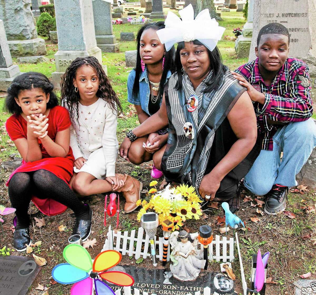Melanie Stengel — New Haven Register From left, Shanya Holland, 8; Shannon Eaddy, 7; Marquise Eaddy Jr., 12; Tenajah McFadden, 15; and Barbara Eaddy at the gravesite of Marquise Eaddy, the chioldren's father and Barbara Eaddy's son.