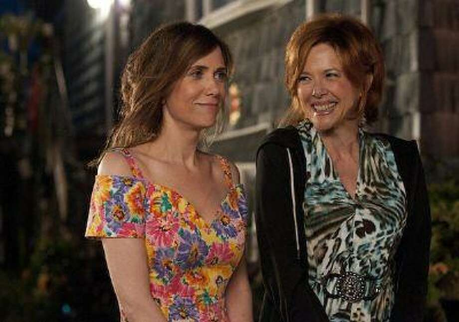 """Bridesmaid's"" Kristen Wiig (left) fakes suicide to jump start her playwright career and gets put in custody of her gambling-addicted mom Annette Bening in ""Girl Most Likely,"" in theaters July 19."