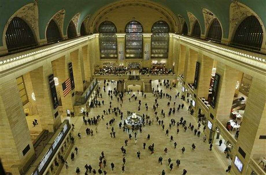 Travelers cross the main concourse of Grand Central Terminal in New York, Wednesday, Jan. 9, 2013, as seen from a bird's eye view through a window near the ceiling. The country's most famous trains station and one of the finest examples of Beaux Arts architecture in America turns 100 Feb. 1.  Its centennial comes 15 years after a triumphant renovation that removed decades of grime and decay. (AP Photo/Kathy Willens) Photo: AP / AP