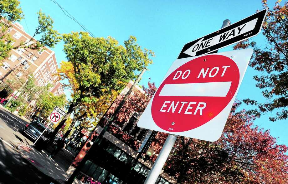 (Arnold Gold — New Haven Register)  Street signs direct traffic at the intersection of two one way streets, Howe Ave. and Chapel St., in New Haven on 10/20/2013. Photo: Journal Register Co.