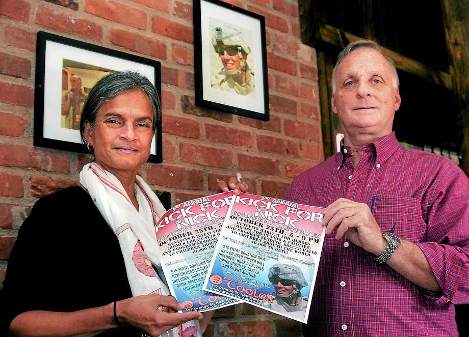Bill and Shalini Madaras, whose son, Nick Madaras, was killed in Iraq, have been raising money and donations of soccer equipment to send to children in Iraq. Photo: Peter Casolino — New Haven Register