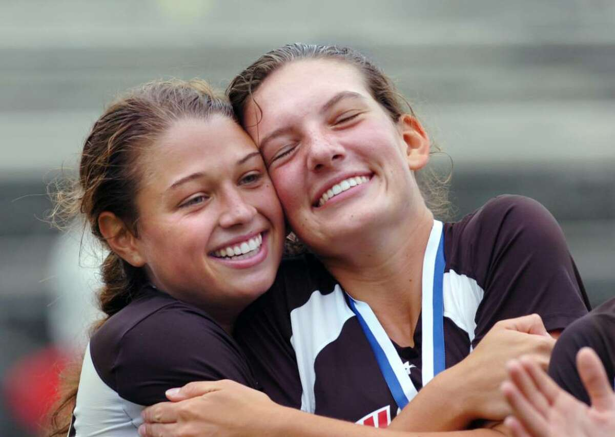 New Canaan High School lacrosse players, Erin Fessler, left, and Julia Tuttle, celebrate a 10-9 state championship victory over Greenwich High School in the 2010 Girls Lacrosse State Division 1 Finals at Bunnell High School, Stratford, Saturday afternoon, June 12, 2010.