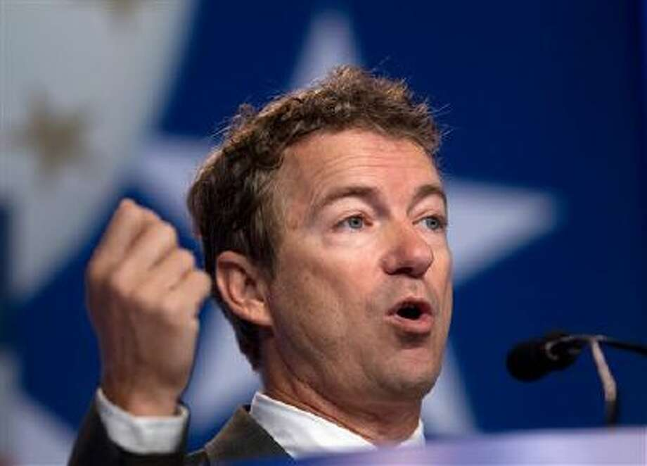 FILE - In this Oct. 11, 2013, file photo, Sen. Rand Paul R-Ky. speaks during the Values Voter Summit, held by the Family Research Council Action in Washington. Paul in recent days has sought to dismiss criticism over similarities between his speeches and entries in Wikipedia, accusing ?footnote police? and ?hacks and haters? for unfairly criticizing him. (AP Photo/Jose Luis Magana, File) Photo: AP / FR159526 AP