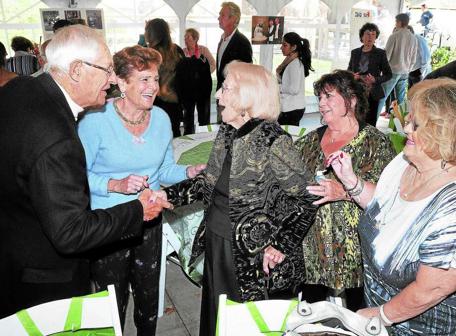 (Arnold Gold — New Haven Register)  Ida Luciani (center) greets Joseph and Annabelle Palmieri (left) of Woodbridge during her 100th birthday party at the Country Club of Woodbridge on 10/20/2013.  She turns 100 on 10/22/2013. Photo: Journal Register Co.