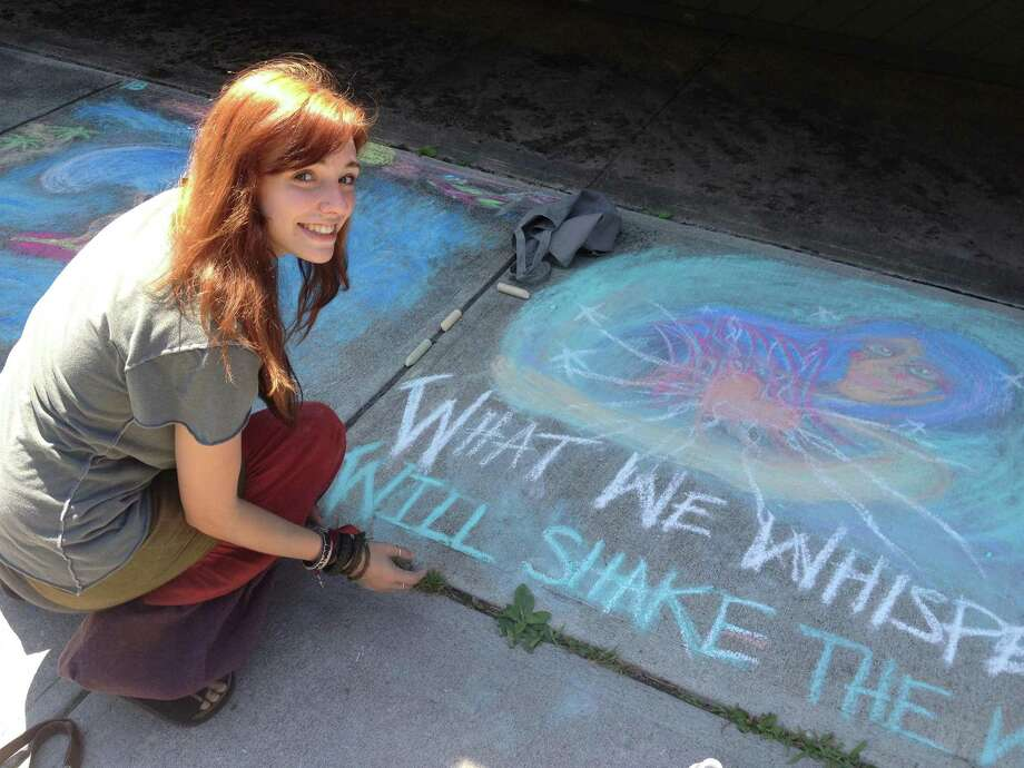 Submitted Photo RJ Wurz decorates the sidewalk in Sylvan Beach at the 2012 Chalk-the-Walk.