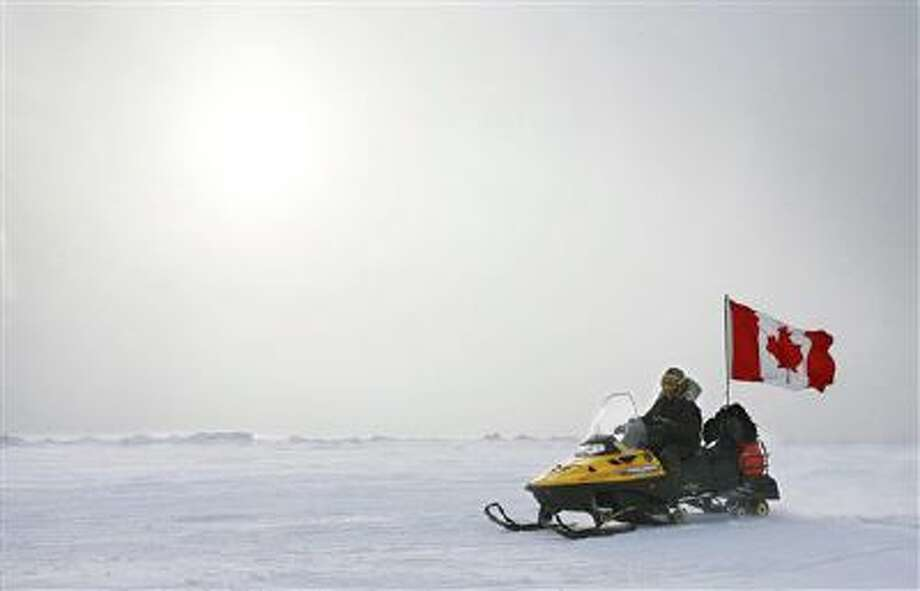 A Canadian Ranger patrols near Eureka, on Ellesmere Island, Nunavut. Canada plans to make a claim to the North Pole in an effort to assert its sovereignty in the resource-rich Arctic. Photo: AP / The Canadian Press
