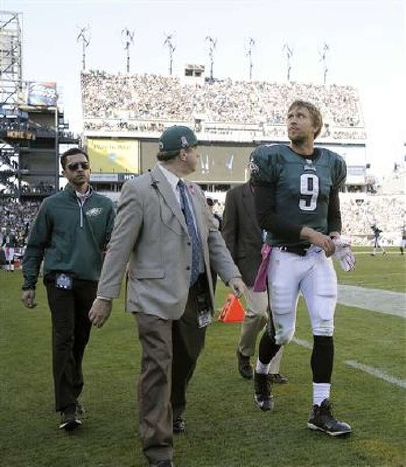 Philadelphia Eagles quarterback Nick Foles (9) leaves the field for examination during the second half of an NFL football game against the Dallas Cowboys, Sunday, Oct. 20, 2013, in Philadelphia. (AP Photo/Michael Perez) Photo: AP / FR168006 AP