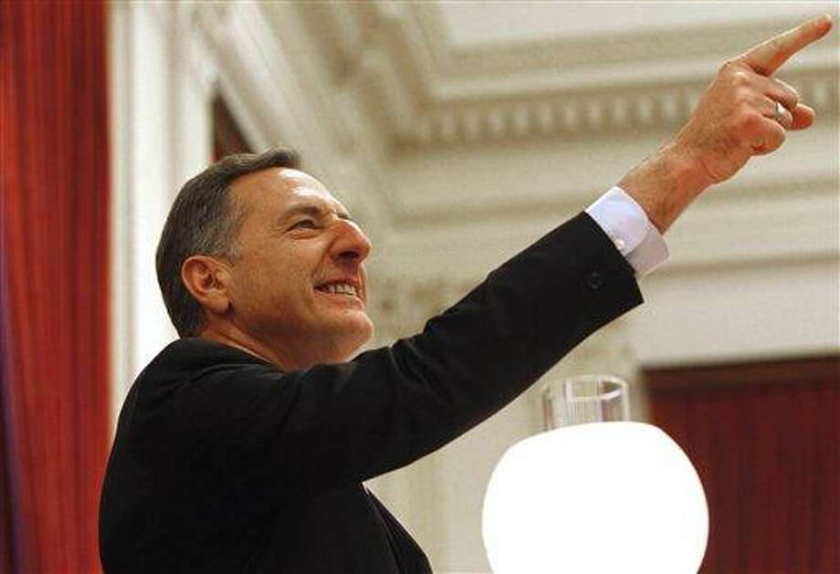 Gov. Peter Shumlin points to supporters during his inauguration to a second term on Thursday, Jan. 10, 2013 in Montpelier, Vt. (AP Photo/Toby Talbot) Photo: AP / AP