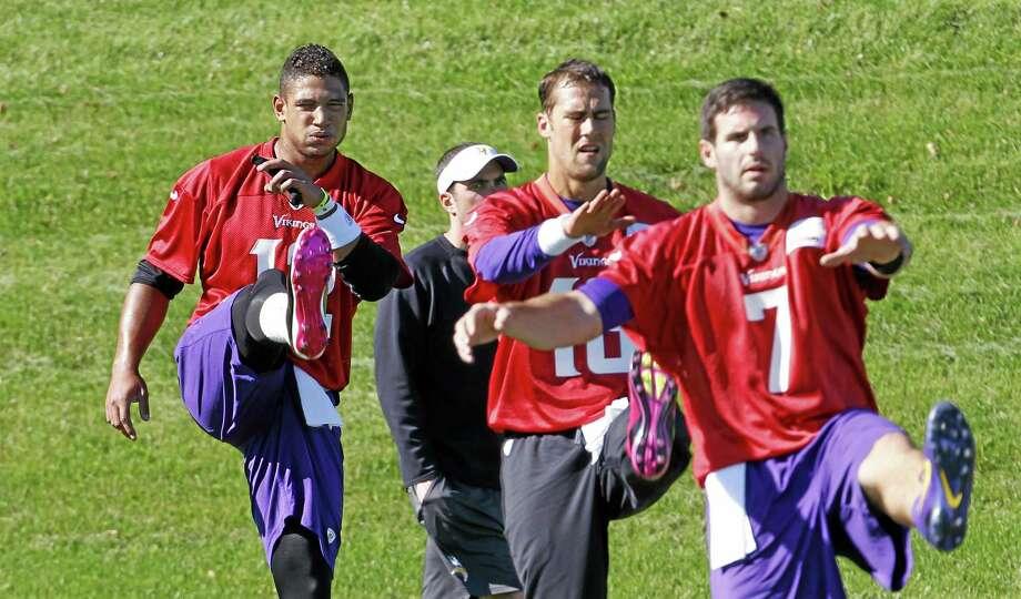 Josh Freeman, left, will get the start for the Vikings Monday night over fellow quarterbacks Matt Cassell, center, and Christian Ponder. Photo: Ann Heisenfelt — The Associated Press   / FR13069 AP