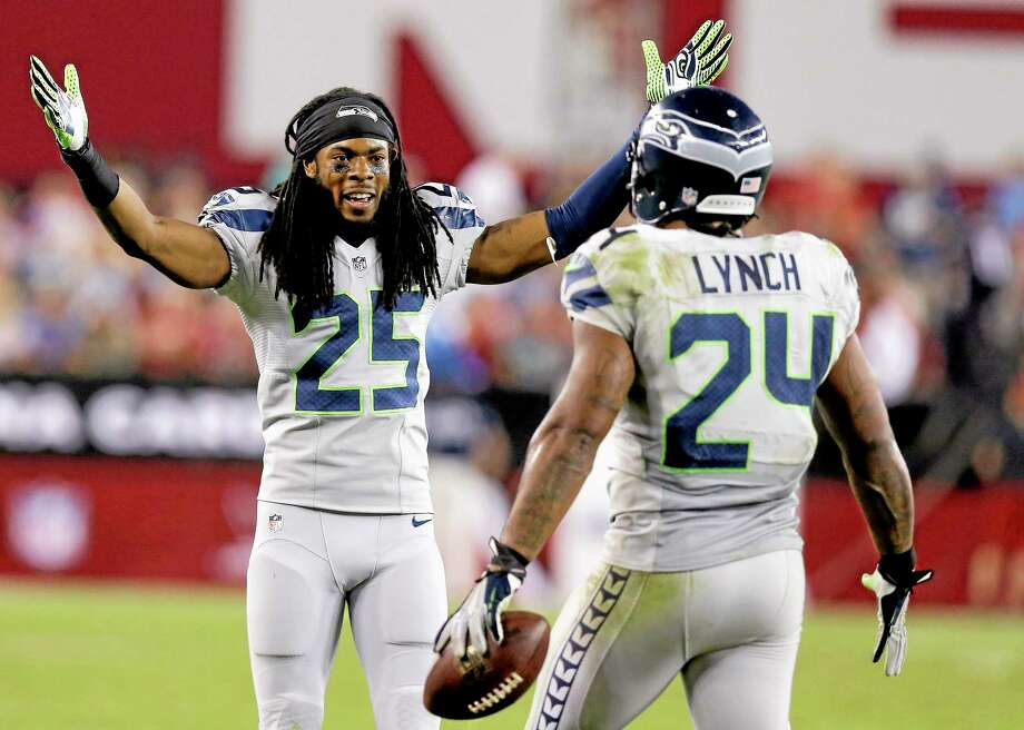 Cornerback Richard Sherman, running back Marshawn Lynch and the Seattle Seahawks have moved back into the No. 2 spot in Mike Wollschlager's Week 7 NFL Register Rankings. Photo: Ross D. Franklin — The Associated Press   / AP AP