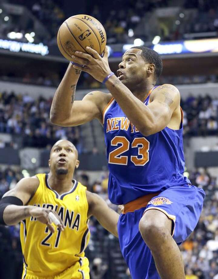 New York Knicks' Marcus Camby (23) goes to the basket against Indiana Pacers' David West (21) during the first half of an NBA basketball game, Thursday, Jan. 10, 2013, in Indianapolis. (AP Photo/Darron Cummings) Photo: AP / AP2013