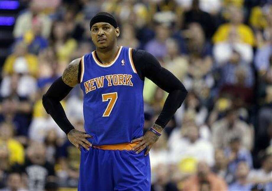 New York Knicks' Carmelo Anthony pauses during the first half of Game 4 of an Eastern Conference semifinal NBA basketball playoff series against the Indiana Pacers on Tuesday, May 14, 2013, in Indianapolis. (AP Photo/Darron Cummings) Photo: AP / AP