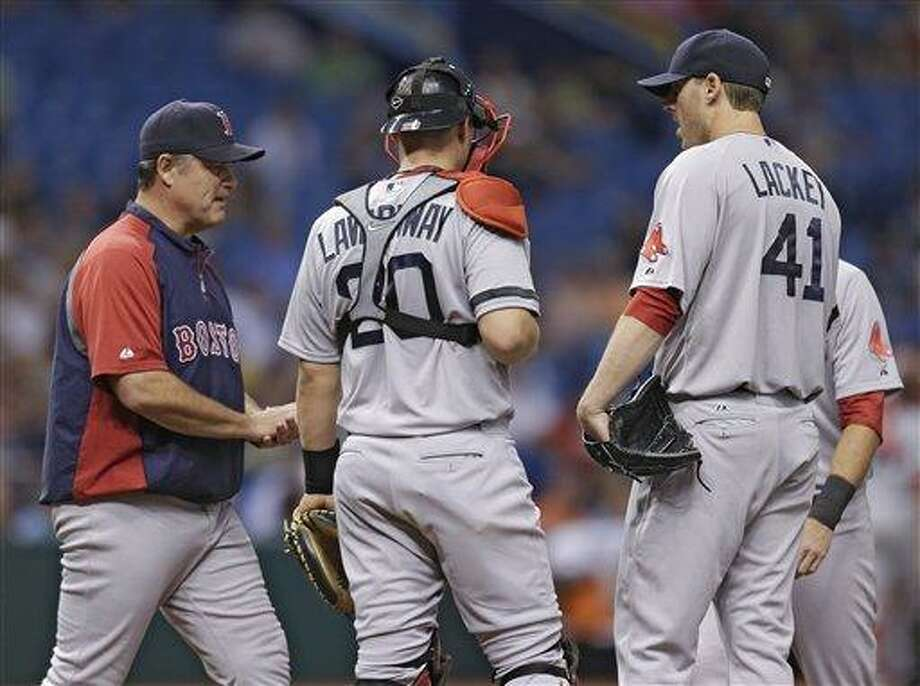 Boston Red Sox manager John Farrell, left, takes starting pitcher John Lackey, right, out of the game against the Tampa Bay Rays during the fifth inning of a baseball game Tuesday, May 14, 2013, in St. Petersburg, Fla. Looking on is Red Sox's catcher Ryan Lavarnway. (AP Photo/Chris O'Meara) Photo: AP / AP