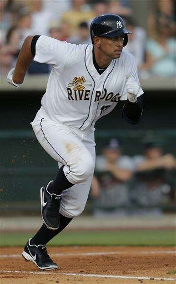 New York Yankees' Alex Rodriguez runs out a ground ball in the first inning in his second rehab game with the Charleston RiverDogs in Charleston, S.C., Wednesday, July 3, 2013. (AP Photo/Chuck Burton) Photo: AP / AP